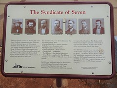 Broken Hill. Information board about the syndicate of seven who formed the Broken Hill Mining Company to mine along the Line of Lode in 1883. The syndicate later became Broken Hill Proprietry .
