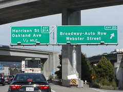 Interstate 580 Eastbound General Douglas MacArthur Freeway EAST Hayward / Stockton approaches at Exit 20 - Webster Street, Broadway - Automobile Row Area followed by Exit 21A - Harrison Street / Oakland Avenue Next Right Exit 1/2 = 0.5 Mile Ahead