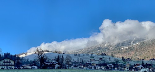 Winter panorama of Thiersee village with mountains in the clouds in Tyrol, Austria