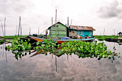 A family living on a floating house located in a branch of the Mahakam river in Borneo, Indonesia