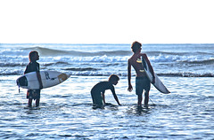 Young surfers. Bali, Indonesia.