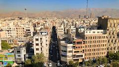 Iran, Tehran - Urban landscape with Alborz mountain range as a backdrop -  October 2019