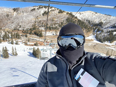Riding the Capitan Quad Chair lift at Ski Apache
