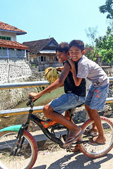 Happy smiling kids on a bike