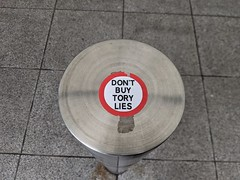 Don't Buy Tory Lies sticker, Heathrow Terminal 5, London, UK