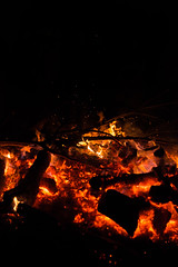 Closeup of raging flames in a large bonfire.