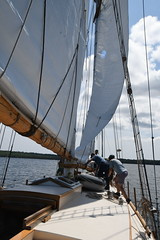 The Crew works to Lower the Sail Aboard the Schooner Huron Jewel