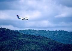 Garuda Indonesia plane flying over a mountain
