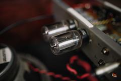 Two tubes next to a soundbox closeup