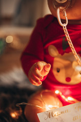A baby hand in closeup festive setting