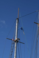 Raising the newly- made Pennant -- The Schooner Huron Jewel at Discovery Harbour, Penetanguishene, Ontario