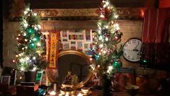 The Christmas Shrine, Buddha, offering of tea, mirror, lit trees, clock, mirror trim, prayer shawl, books, incense, lighters, offering bowl, candles, Impeachment peaches, Christmas season, Lakota Lhamo Ling, Washington, USA