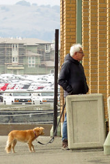 Man and dog looking in at no dogs allowed Craneway Pavilion crafts fair Richmond California 191221-142241 cw50 C4