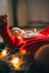 A child tangled in christmas lights