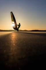 Winter surfer on the ice lake Kallavesi