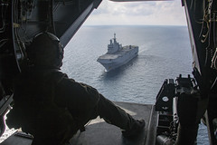 A U.S. Marine observes the French navy amphibious assault ship BPC Dixmude (L9015) in the Atlantic Ocean, Jan. 6, 2020.
