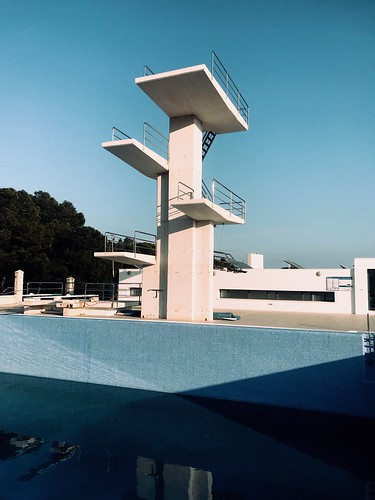 Diving board over empty pool