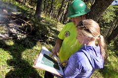 District Conservationist - Erin Kurtz (right) with landowner