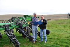 Agronomist - Nick Sirovatka (right) with farmer