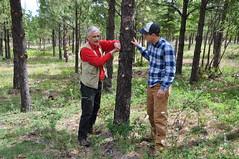 Soil Conservationist Garrett Duyck (right) with landowner