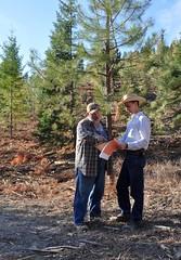 Soil Conservationist - Nick Vora (right) with landowner