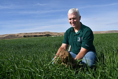 District Conservationist - Lynn Larsen with soil_2