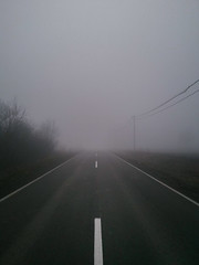 Image of a road through a foggy