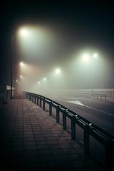 Urban scene during a foggy night.