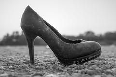 Close-up of a thrown away high heel
