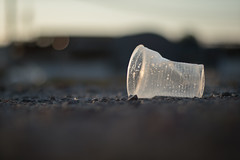 Thrown away plastic cup on the ground