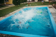 Splashing water in a pool outdoors