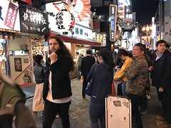 It takes all types- a long haired Western tourist on the Dotonbori food street