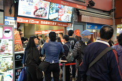 Long queues outside a cafe- it's for sushi, a Western tourist told me