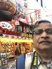 A selfie by an attractive restaurant display in Shinsekai