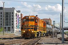 A pair of Utah Railway GP38-3's work in downtown Salt Lake City.