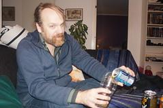 Daniel pours a beer