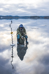 Ice fishing on the lake Kallavesi
