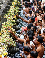 Spiritual purification ritual in Tirta Empul temple. Bali, Indonesia.
