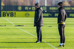 Borussia Dortmund manager Lucien Favre shouts instructions to his players, with captain Marco Reus by his side