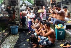 Balinese people praying at Tirta Empul temple