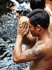 Balinese man praying in Tirta Empul temple