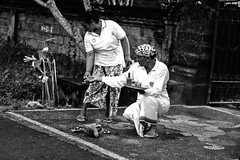 Balinese couple performing street offering