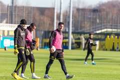 Borussia Dortmund players Marwin Hitz, Manuel Akanji and Mats Hummels at the end of their training on a sunny day