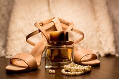 Brown glass fragrance bottle beside white pearl bracelets - Credit to https://homegets.com/