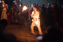 Fire artist twirling a fire staff