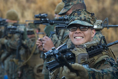 A Sailor shows his rifle barrel all-clear on line before a live fire exercise.