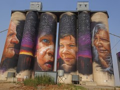 Sheep Hills near Warracknabeal. Stunning Silo Art. Depicts four local Aboriginal people with a starry night sky. Two adults and two children.