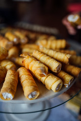 rolled sweets on a plate display filled with whipped cream