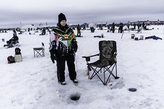 Ice fishing at The Brainerd Jaycees Ice Fishing Extravaganza on Gull Lake's Hole-in-the-Day Bay in Minnesota.