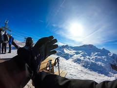 Skier putting on skiing gloves
